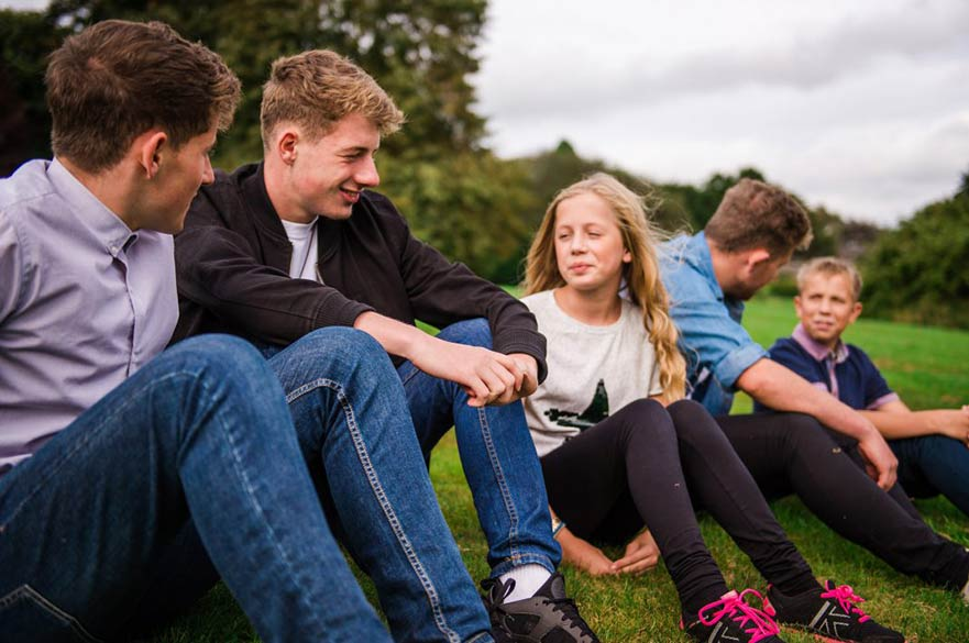 Young people sitting on grass